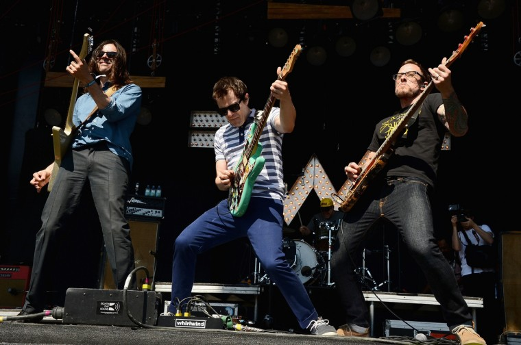 (L-R) Brian Bell, Rivers Cuomo and Scott Shriner of Weezer perform onstage during day 4 of the Firefly Music Festival on June 22, 2014 in Dover, Delaware. (Theo Wargo/Getty Images)