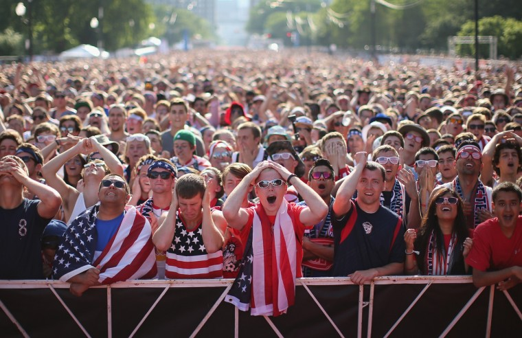 Fans gather in Grant Park to watch the U.S. play Portugal in a Group G World Cup soccer match on June 22, 2014 in Chicago, Illinois. Fans were turned away from the free event after a 10,000-person capacity was reached. (Scott Olson/Getty Images)