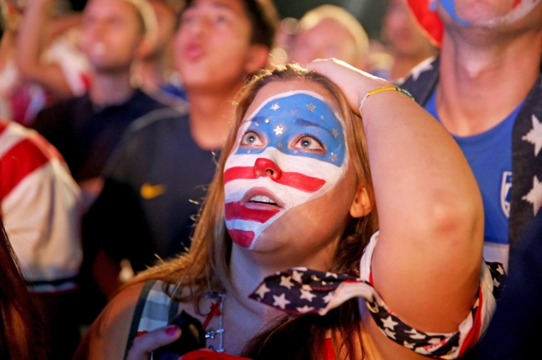 USA soccer fans react to Portugal scoring their 2nd goal as they watch on a screen setup at the FIFA Fan Fest on Copacabana beach June 22, 2014 in Rio de Janeiro, Brazil. The game ended tied 2-2. (Joe Raedle/Getty Images)