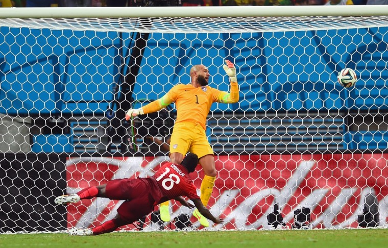 Silvestre Varela of Portugal scores his team's second goal as goalkeeper Tim Howard of the United States looks on during the 2014 FIFA World Cup Brazil Group G match between the United States and Portugal at Arena Amazonia on June 22, 2014 in Manaus, Brazil. (Christopher Lee/Getty Images)