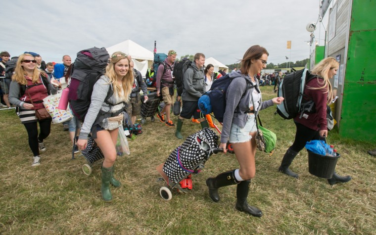 Festival goers arrive at Worthy Farm in Pilton for the first day of the 2014 Glastonbury Festival on June 25, 2014 in Glastonbury, England. Gates opened today at the Somerset dairy farm that plays host to one of the largest music festivals in the world. Tickets to the event, which is now in its 44th year, sold out in minutes even before any of the headline acts had been confirmed. The festival, which started in 1970 with several hundred hippies, now attracts more than 175,000 people. (Matt Cardy/Getty Images)