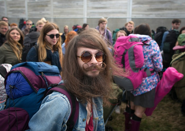 Bryan Patterson, 28, from Liverpool poses for a photograph as he queues to get into Worthy Farm in Pilton for the first day of the 2014 Glastonbury Festival on June 25, 2014. (Matt Cardy/Getty Images)