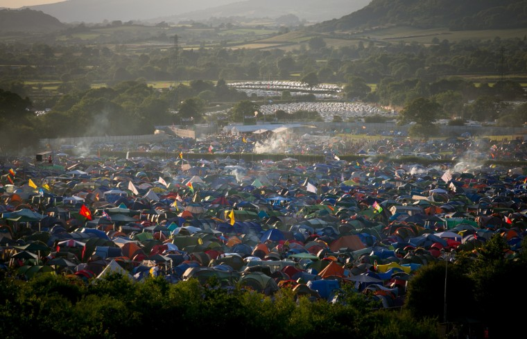 Smoke rises from festival revellers' tents pitched at Worthy Farm in Pilton on the first day of the 2014 Glastonbury Festival. (Matt Cardy/Getty Images)