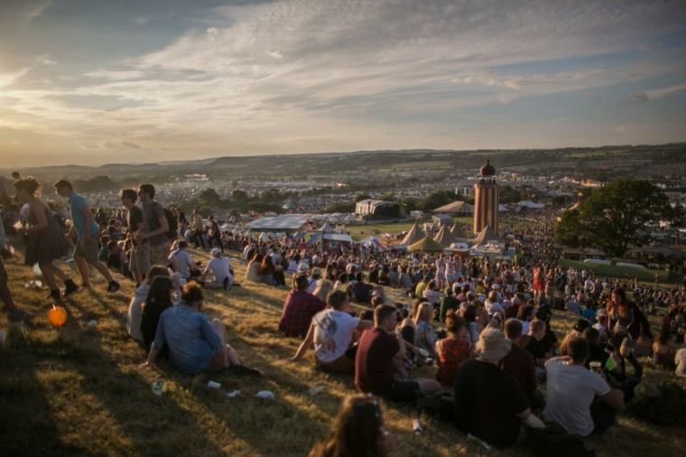 People gather to watch the sun set at Worthy Farm in Pilton on the first day of the 2014 Glastonbury Festival on June 25, 2014 in Glastonbury, England. (Matt Cardy/Getty Images)