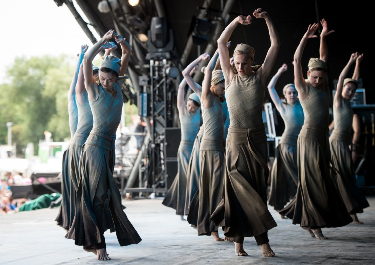Dancers of the English National Ballet perform 'Dust', choreographed by Akram Khan, from 'Lest We Forget' on the Pyramid Stage, on the last day of the Glastonbury Festival at Worthy Farm, Pilton on June 29, 2014 in Glastonbury, England. (Ian Gavan/Getty Images)