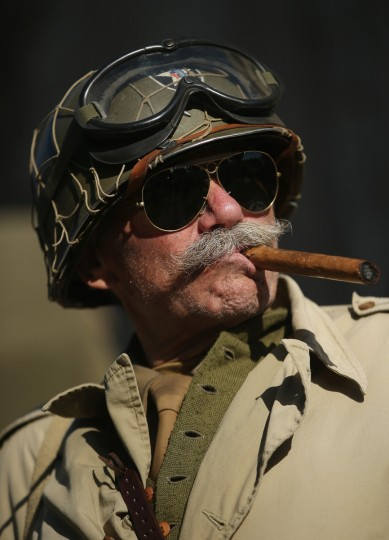A D-Day re-enactment enthusiast from Belgium dressed as World War II American soldier from the 2nd Infantry Division relaxes at his camp on June 4, 2014 near Utah Beach in Sainte Marie du Mont, France. (Sean Gallup/Getty Images)