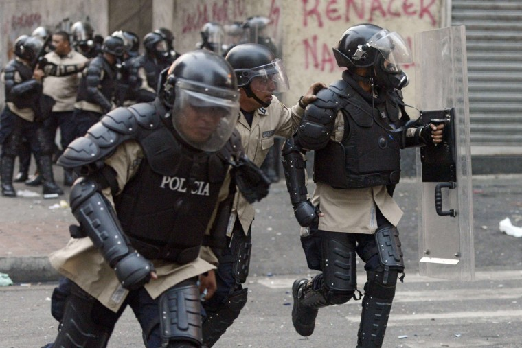 Riot policemen are deployed during a protest against Venezuelan President Nicolas Maduro in Caracas. (Leo Ramirez/Getty Images)