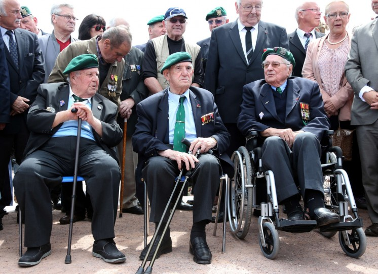 Veterans of Kieffer commando (LtoR) Rene Rossey, Leon Gautier and Jean Morel attend a ceremony near a monument honoring their commando a day ahead of the start of D-Day commemorations. (Ludovic Marin/Getty Images)