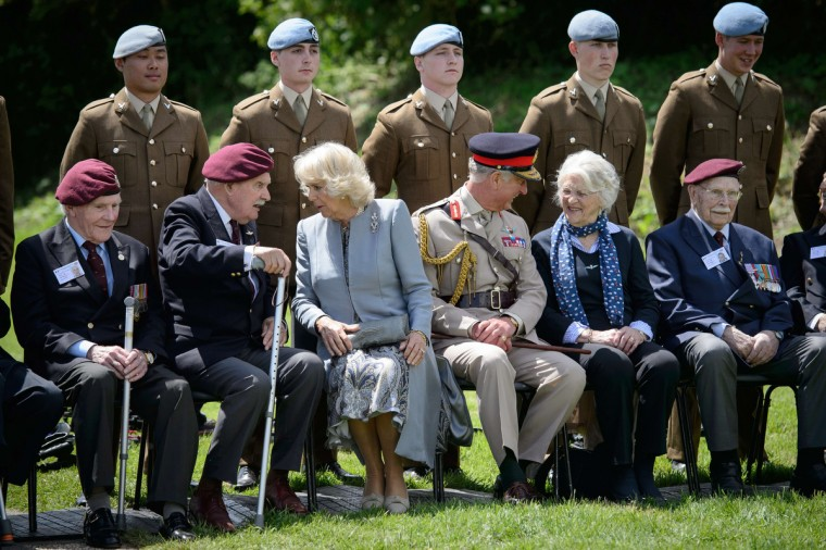 Britain's Prince Charles (C-R) and the Duchess of Cornwall Camilla (C-L) meet glider pilot veterans during a commemoration event at the Pegasus bridge, in Benouville, northern France, on June 5, 2014, marking the 70th anniversary of the World War II Allied landings in Normandy. (Leon Neal/Getty Images)