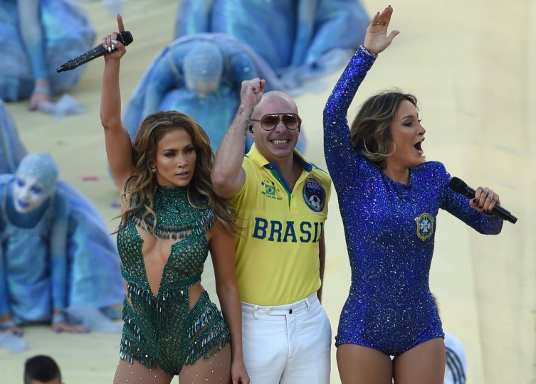 US rapper Pitbull (C) Brazilian pop singer Claudia Leitte (R) and US singer Jennifer Lopez (L) take part in the opening ceremony of the 2014 FIFA World Cup at the Corinthians Arena in Sao Paulo on June 12, 2014, prior to the opening Group A football match between Brazil and Croatia. (Pedro Ugarte/Getty Images)
