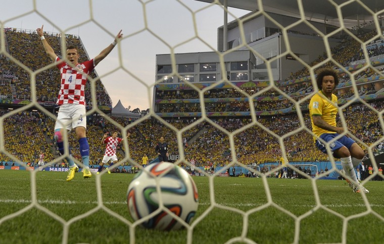 Croatia's midfielder Ivan Perisic (L) celebrates a goal against Brazil as Brazilian defender Marcelo (R) looks on during their Group A football match at the Corinthians Arena in Sao Paulo during the 2014 FIFA World Cup on June 12, 2014. (Odd Andersen/Getty Images)