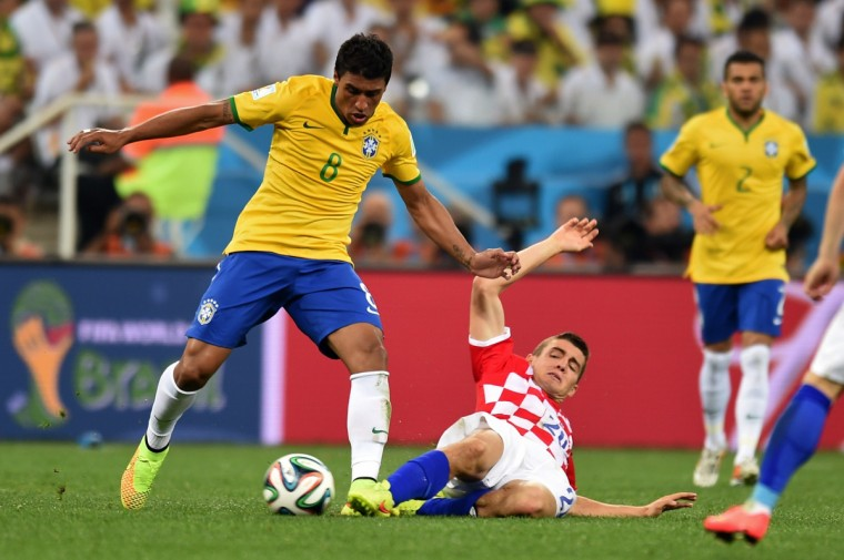 Brazil's midfielder Paulinho and Croatia's midfielder Mateo Kovacic vie for the ball during a Group A football match between Brazil and Croatia at the Corinthians Arena in Sao Paulo during the 2014 FIFA World Cup on June 12, 2014. (Vanderlei Almeida/Getty Images)
