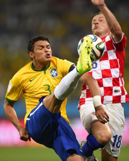 Brazil's defender and captain Thiago Silva (L) and Croatia's forward Ivica Olic vie for the ball during a Group A football match between Brazil and Croatia at the Corinthians Arena in Sao Paulo during the 2014 FIFA World Cup on June 12, 2014. (Fabrice Coffrini/Getty Images)