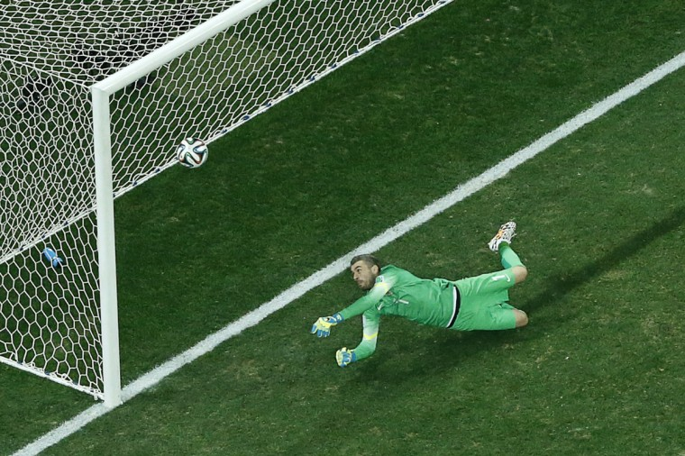 Croatia's goalkeeper Stipe Pletikosa fails to save a penalty from Brazil's forward Neymar during the 2014 FIFA World Cup Group A football match at the Corinthians Arena in Sao Paulo on June 12, 2014. (Fabrizio Bensch/Getty Images)