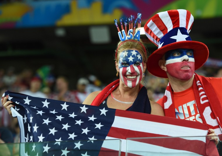 US fans cheer during a Group G football match between Ghana and US at the Dunas Arena in Natal during the 2014 FIFA World Cup. (Emmanuel Dunand/AFP/Getty Images)