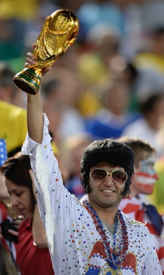 A fan holds a replica of the World Cup trophy during a Group G football match between Ghana and US at the Dunas Arena in Natal during the 2014 FIFA World Cup. (Emmanuel Dunand/AFP/Getty Images)