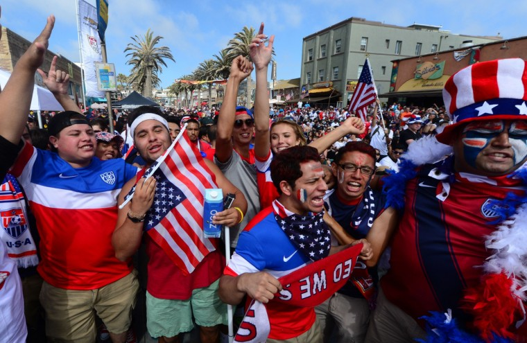 US soccer fans celebrate victory over Ghana from the pier at Hermosa Beach, California on June 16, 2014, as the United States defeated Ghana 2-1 in their first round World Cup match in Brazil. (Frederic J. Brown/AFP/Getty Images)