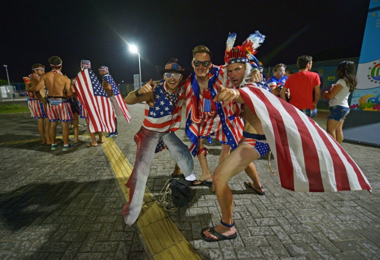 US football fans celebrate after their team beat Ghana 2-1 in their first match of the 2014 FIFA football World Cup outside the Das Dunas Stadium, Natal4. (Carl de Souza/AFP/Getty Images)