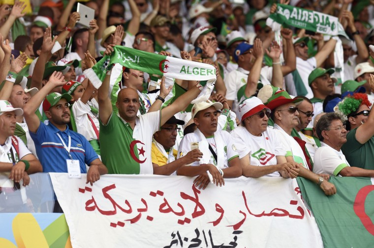 Algeria fans are pictured before the start of the Group H football match between Belgium and Algeria at the Mineirao Stadium in Belo Horizonte during the 2014 FIFA World Cup on June 17, 2014. (Philippe Desmazes/AFP/Getty Images)