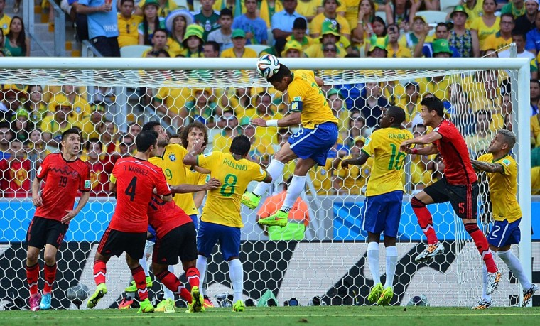 Brazil's defender Thiago Silva (C) heads the ball during a Group A football match between Brazil and Mexico in the Castelao Stadium in Fortaleza during the 2014 FIFA World Cup on June 17, 2014. (Yuri Cortez/Getty Images)