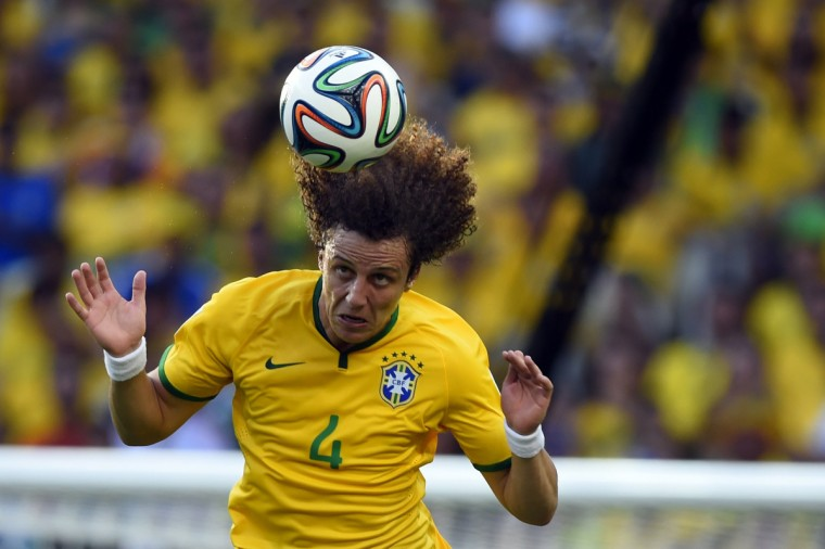 Brazil's defender David Luiz jumps for the ball during a Group A football match between Brazil and Mexico in the Castelao Stadium in Fortaleza during the 2014 FIFA World Cup on June 17, 2014. (Odd Andersen/Getty Images)