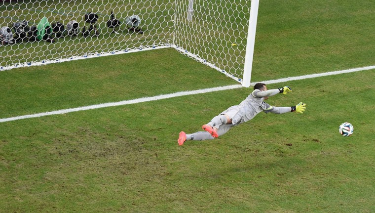Brazil's goalkeeper Julio Cesar dives for the ball during a Group A football match between Brazil and Mexico in the Castelao Stadium in Fortaleza during the 2014 FIFA World Cup on June 17, 2014. (Francois Xavier Marit/Getty Images)