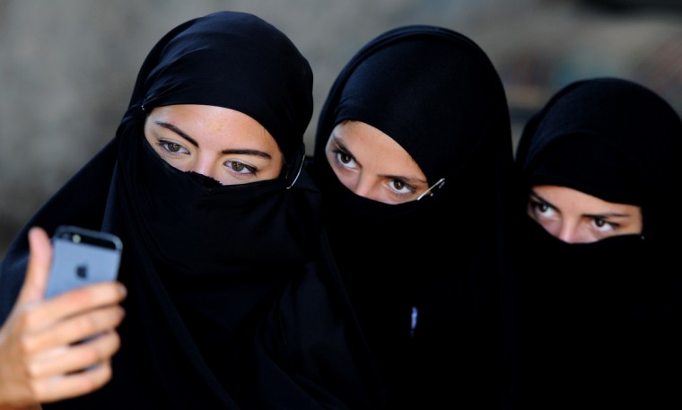 "Georgian actors take a picture of themselves wearing veils before taking part in a joint Georgian-US military counterterrorism exercise called ""Agile Spirit 2014"" at the Vaziani military base outside Tbilisi. (Vano Shlamov/Getty Images)"