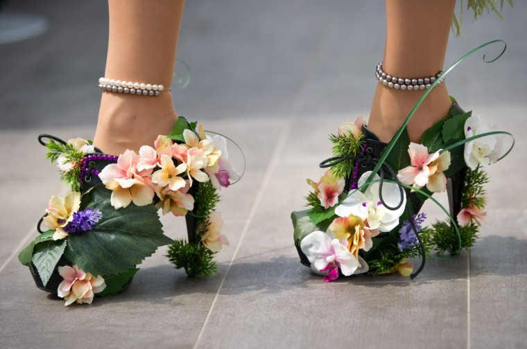 "A man walks with flower decorated High Heels in Berlin during the ""Drag Walk Casting"" ahead of the Christopher Street Parade. The Christopher Street Day takes place on June 21, 2014. (Daniel Naupold/Getty Images)"