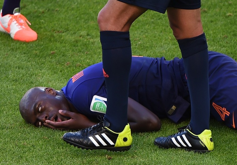 Netherlands' defender Bruno Martins Indi reacts after being tackled during a Group B football match between Australia and the Netherlands at the Beira-Rio Stadium in Porto Alegre during the 2014 FIFA World Cup on June 18, 2014. (Luis Acosta/AFP/Getty Images)