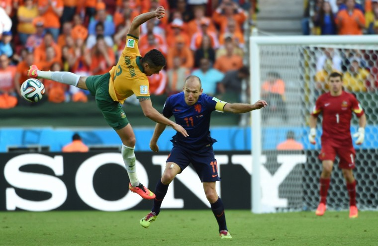 Netherlands' forward Arjen Robben (C) vies with Australia's defender Jason Davidson during a Group B football match between Australia and the Netherlands at the Beira-Rio Stadium in Porto Alegre during the 2014 FIFA World Cup on June 18, 2014. (William West/AFP/Getty Images)