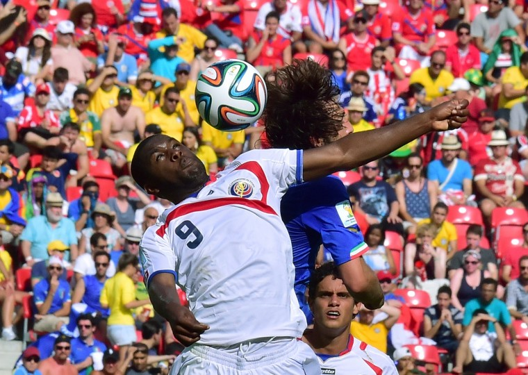 Costa Rica's forward Joel Campbell (L) in action during a Group D match between Italy and Costa Rica at the Pernambuco Arena in Recife during the 2014 FIFA World Cup on June 20, 2014. (Giuseppe Cacace/AFP/Getty Images)