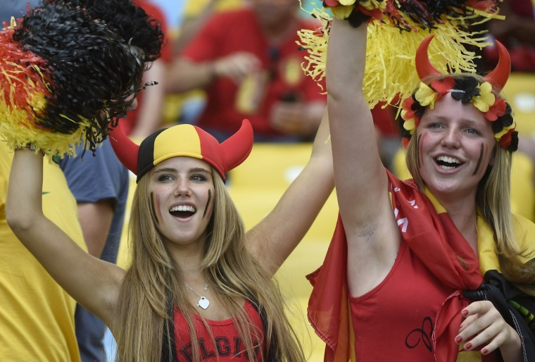 Belgium's supporters cheer as they wait for the start of the Group H football match between Belgium and Russia at the Maracana Stadium in Rio de Janeiro during the 2014 FIFA World Cup on June 22, 2014. (Martin Bureau/Getty Images)