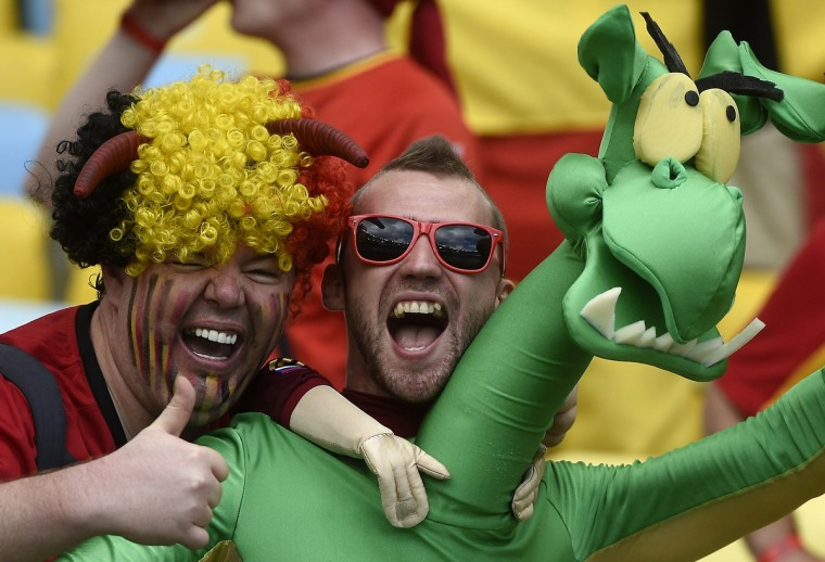 Belgium's supporters joke as they wait for the start of the Group H football match between Belgium and Russia at the Maracana Stadium in Rio de Janeiro during the 2014 FIFA World Cup on June 22, 2014. (Martin Bureau/Getty Images)