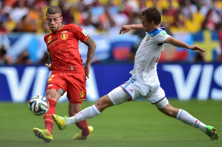 Belgium's defender Toby Alderweireld (L) kicks the ball past Russia's forward Maxim Kanunnikov during the Group H football match between Belgium and Russia at The Maracana Stadium in Rio de Janeiro on June 22, 2014, during the 2014 FIFA World Cup. (Gabriel Bouys/Getty Images)
