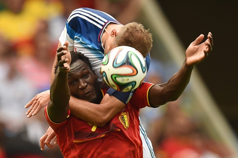 Belgium's forward Romelu Lukaku (L) is tackled by Russia's defender Vasily Berezutsky during the Group H football match between Belgium and Russia at The Maracana Stadium in Rio de Janeiro on June 22, 2014, during the 2014 FIFA World Cup. (Kirill Kudravtsev/Getty Images)