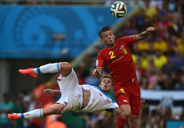 Belgium's defender Toby Alderweireld (R) heads the ball past Russia's forward Alexander Kokorin during the Group H football match between Belgium and Russia at The Maracana Stadium in Rio de Janeiro on June 22, 2014, during the 2014 FIFA World Cup. (Gabriel Bouys/Getty Images)