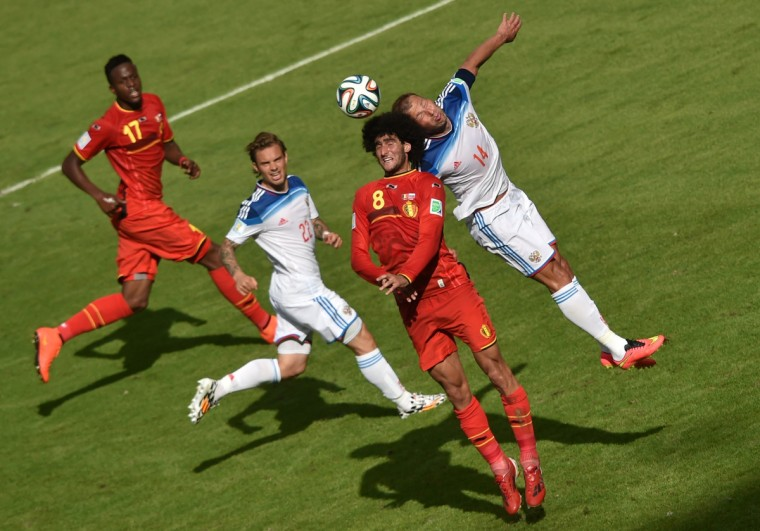 Belgium's midfielder Marouane Fellaini (2R) and Russia's defender Vasily Berezutsky (R) challenge for the ball as Russia's defender Andrei Yeshchenko (2L) and Belgium's forward Divock Origi (L) look on during the Group H football match between Belgium and Russia at The Maracana Stadium in Rio de Janeiro on June 22, 2014, during the 2014 FIFA World Cup. (Yasuyoshi Chiba/Getty Images)
