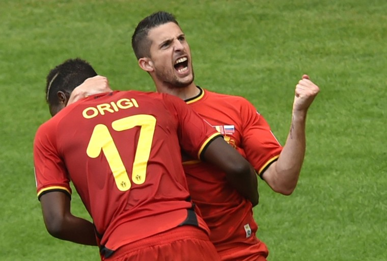 Belgium's forward Divock Origi (L) celebrates after scoring with teammate Belgium's forward Kevin Mirallas during the Group H football match between Belgium and Russia at The Maracana Stadium in Rio de Janeiro on June 22, 2014, during the 2014 FIFA World Cup. (Yasuyoshi Chiba/Getty Images)