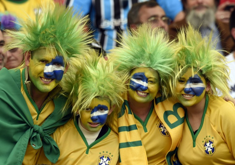 Fans cheer before a Group H football match between South Korea and Algeria at the Beira-Rio Stadium in Porto Alegre during the 2014 FIFA World Cup on June 22, 2014. (Philippe Desmazes/Getty Images)