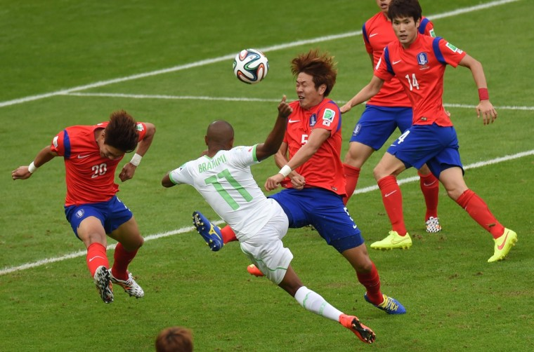 South Korea's defender Hong Jeong-Ho (L) and South Korea's defender Kim Young-Gwon (3L) fight for the ball with Algeria's midfielder Yacine Brahimi during a Group H football match between South Korea and Algeria at the Beira-Rio Stadium in Porto Alegre during the 2014 FIFA World Cup on June 22, 2014. (Pedro Ugarte/Getty Images)