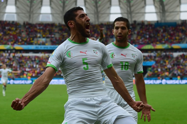 Algeria's defender Rafik Halliche (C) celebrates scoring with Algeria's forward Abdelmoumene Djabou (R) during a Group H football match between South Korea and Algeria at the Beira-Rio Stadium in Porto Alegre during the 2014 FIFA World Cup on June 22, 2014. (Jung Yeon-Je/Getty Images)