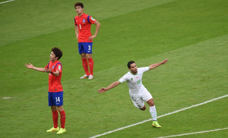 Algeria's forward Abdelmoumene Djabou (R) celebrates scoring as South Korea's midfielder Han Kook-Young and South Korea's defender Yun Suk-Young (top) react during a Group H football match between South Korea and Algeria at the Beira-Rio Stadium in Porto Alegre during the 2014 FIFA World Cup on June 22, 2014. (Pedro Ugarte/Getty Images)
