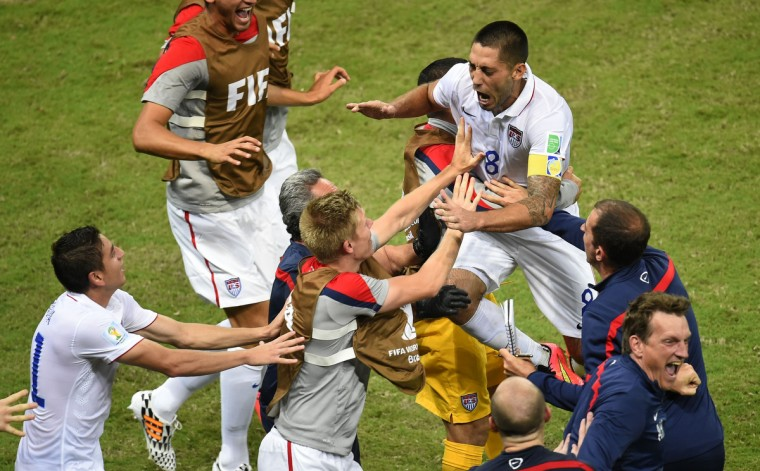 US forward Clint Dempsey celebrates with teammates after scoring during a Group G football match between USA and Portugal at the Amazonia Arena in Manaus during the 2014 FIFA World Cup on June 22, 2014. (Fabrice Coffrini/Getty Images)
