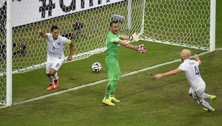 US forward Clint Dempsey (L) celebrates after scoring during a Group G football match between USA and Portugal at the Amazonia Arena in Manaus during the 2014 FIFA World Cup on June 22, 2014. (Fabrice Coffrini/Getty Images)
