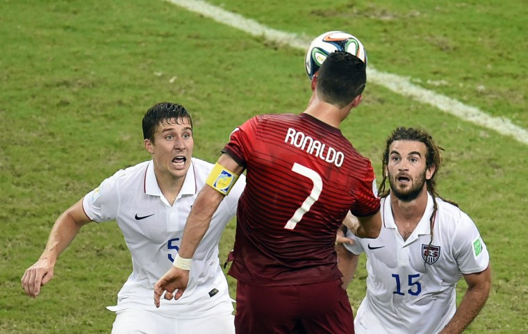Portugal's forward Cristiano Ronaldo heads the ball during a Group G football match between USA and Portugal at the Amazonia Arena in Manaus during the 2014 FIFA World Cup on June 22, 2014. (Fabrice Coffrini/Getty Images)
