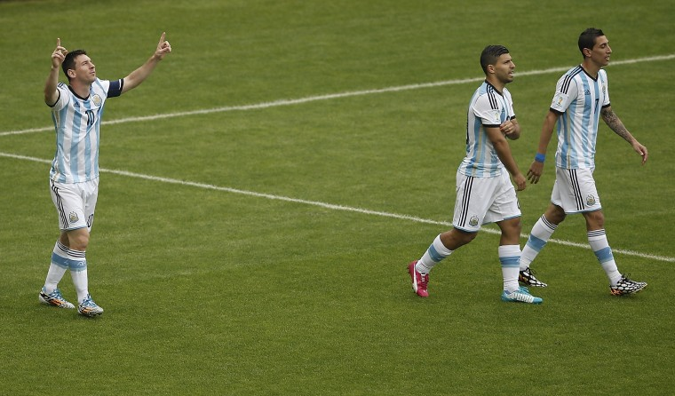 Argentina's forward and captain Lionel Messi (L) celebrates with teammates Argentina's midfielder Angel Di Maria (R) and Argentina's forward Sergio Aguero (C) after scoring during the Group F football match between Nigeria and Argentina at the Beira-Rio Stadium in Porto Alegre on June 25, 2014,during the 2014 FIFA World Cup. (Adrian Dennis/AFP/Getty Images)