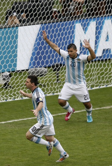 Argentina's forward Sergio Aguero (R) celebrates after teammate Lionel Messi (L) scored a goal during the Group F football match between Nigeria and Argentina at the Beira-Rio Stadium in Porto Alegre on June 25, 2014,during the 2014 FIFA World Cup. (Adrian Dennis/AFP/Getty Images)