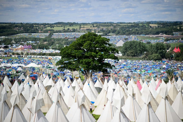 Finishing touches are made to the tipis as the gates open at the Glastonbury Festival of Music and Performing Arts in Somerset, southwest England. (Leon Neal/Getty Images)