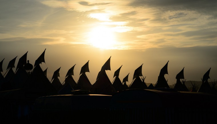 The sun begins to set over the Tipi field, ahead of this weekends Glastonbury Festival of Music and Performing Arts on Worthy Farm in Somerset, south west England, on June 25, 2014. (Leon Neal/Getty Images)