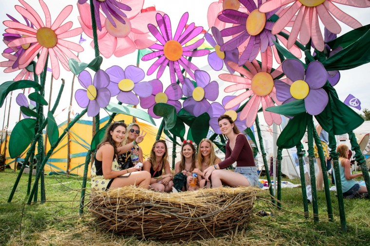 A group of festival goers sit in a nest as revellers gather ahead of this weekends Glastonbury Festival of Music and Performing Arts on Worthy Farm near Pilton in Somerset, south west England, on June 26, 2014. (Leon Neal/Getty Images)